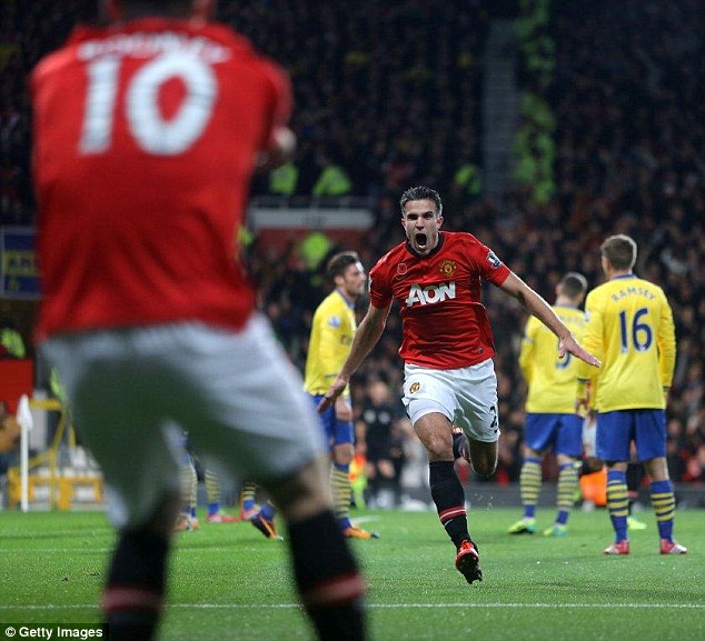Take that! Robin van Persie celebrates scoring for Manchester United against Arsenal in November