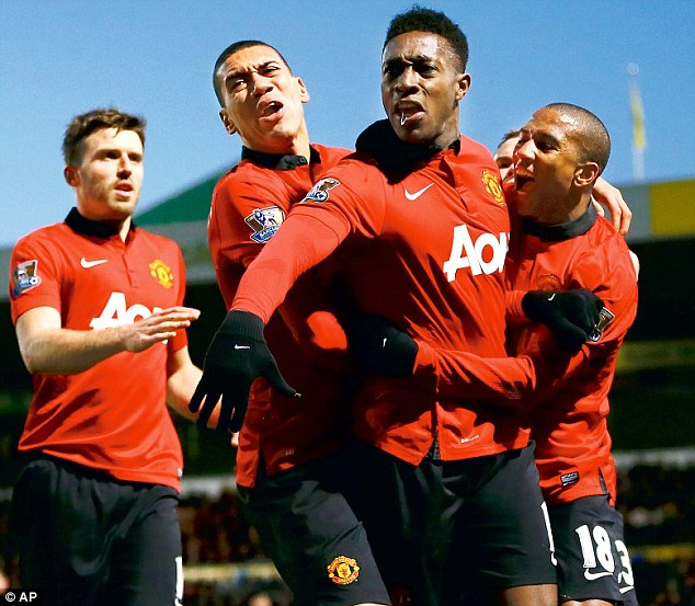 In form: Danny Welbeck (second right) has been justifying his manager's faith in recent weeks