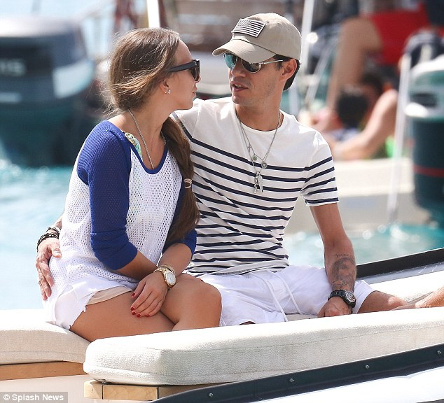 Tender moment: Marc and Chloe gaze into one another's eyes as they sit on the boat