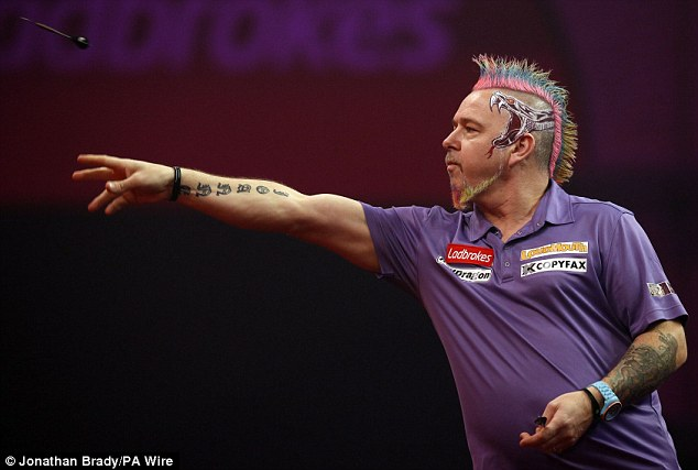 Colourful: Wright's extravagent hair and loud outfits have lit up Ally Pally over the past few weeks