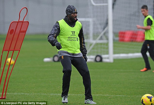 Keeping warm: Liverpool's Kolo Toure in training ahead of Wednesday's match against Hull City
