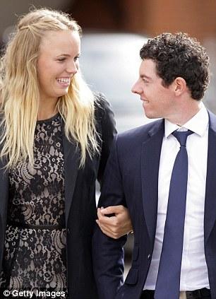Star couple: The happy couple at Newbury Racecourse in 2012