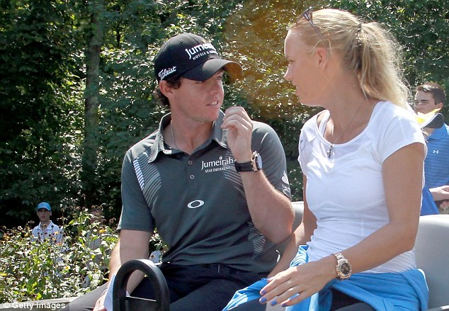 Workout: Wozniacki greets her man in gym gear at the end of a round in Boston Massachusetts