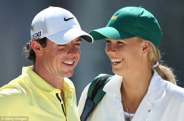 Smitten: True love means Wozniacki being willing to serve as caddie to McIlroy, as she did for the Par 3 Contest before the Masters
