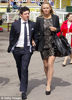 They're ace: McIlroy and Wozniacki at the Dubai Duty Free Race Day at Newbury Racecourse in April 2012