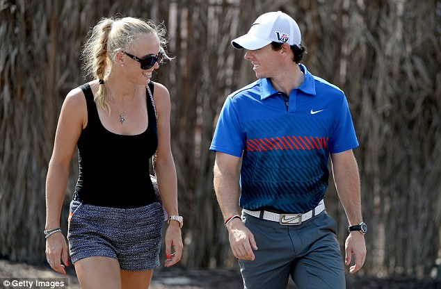 Success: Wozniacki with McIlroy at the DP World Tour Championship in Dubai in November last year