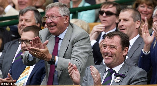 Different ball game: Ferguson was at Wimbledon to cheer on fellow Scot Andy Murray during the summer