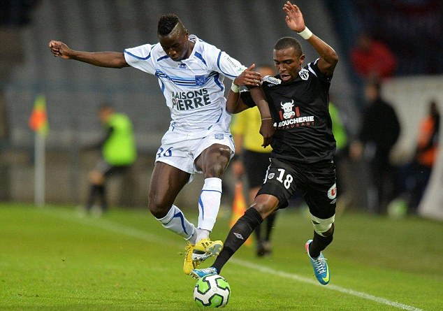 Being watched: Everton are also monitoring Auxerre's Cameroonian striker Paul-Georges Ntep (left)