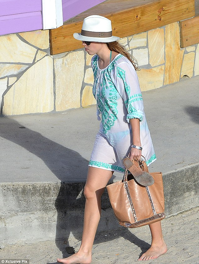 Chic looks: The princess wore a see-through white and green Melissa Odabash kaftan as she enjoyed her day on the beach on her New Year trip