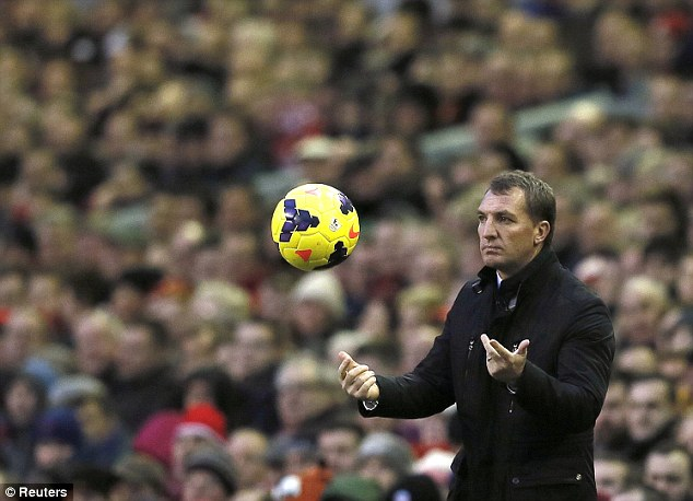 On the ball: Rodgers throws the ball back after it bounced into his technical area