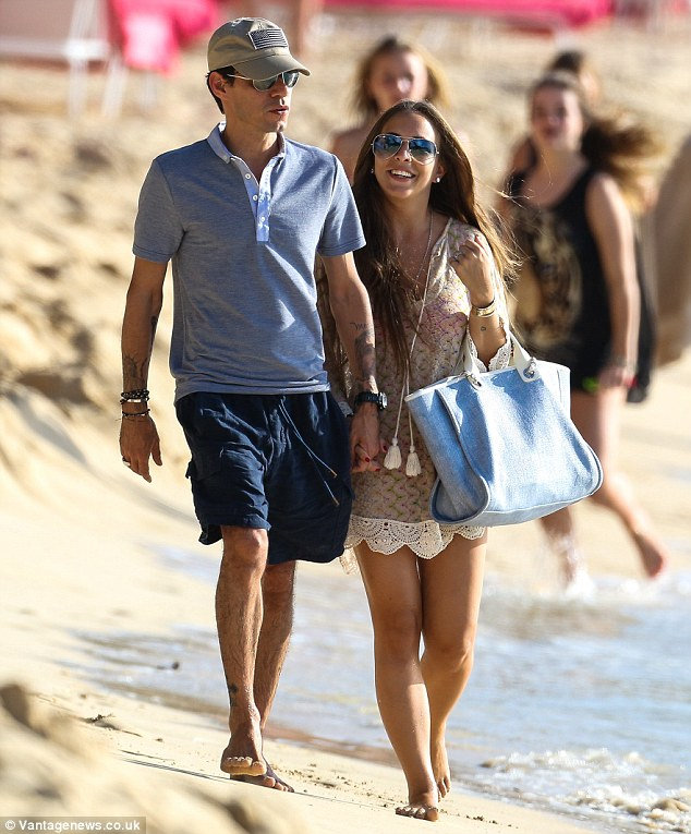 Happy New Year! Chloe Green and Marc Anthony seemed to be positively giddy at the prospect of what lies in store for them throughout 2014 as they stepped out on a romantic beach walk in Barbados on Wednesday afternoon