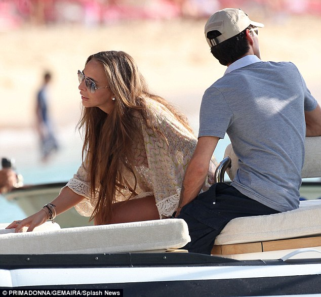Life at sea: Wearing her long brunette locks flowing around her shoulders, the former Made In Chelsea star completed her ensemble with dazzling diamond earrings and multiple beaded bracelets as she hopped on board a speedboat with Marc