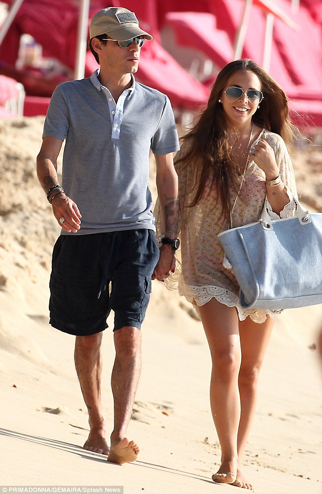 Tickled pink: The 22-year-old Topshop heiress and her 45-year-old beau looked more in love than ever as they erupted into a fit of giggles while walking hand-in-hand down the pristine white sands together