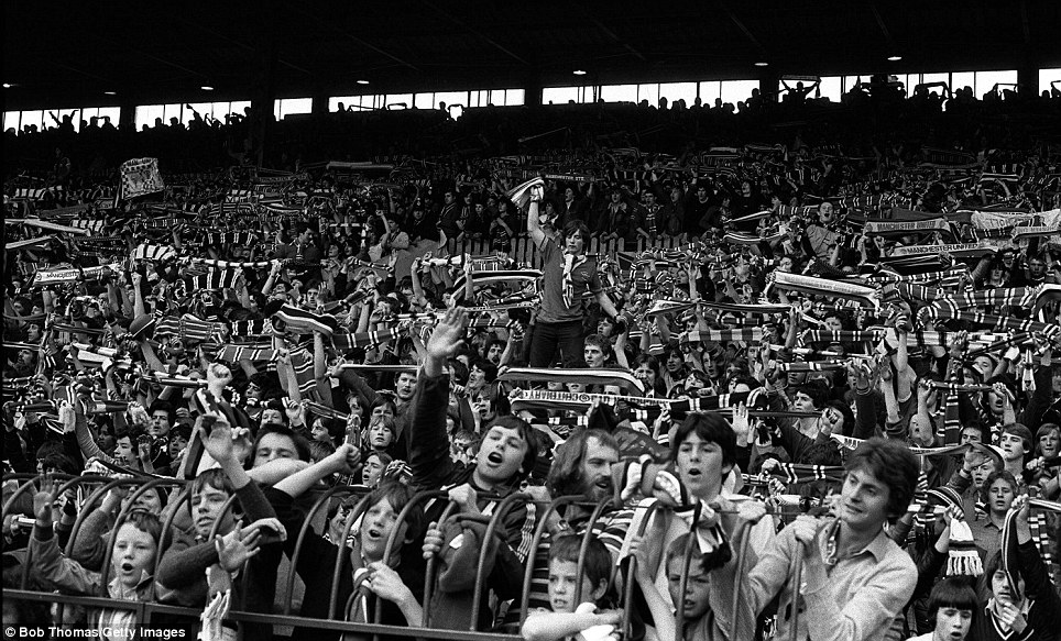 Football, 26th April 1980, Old Trafford, Manchester, Manchester United v Coventry City, Manchester United fans pictured on the Stretford End at Old Trafford during the game  (Photo by Bob Thomas/Getty Images)