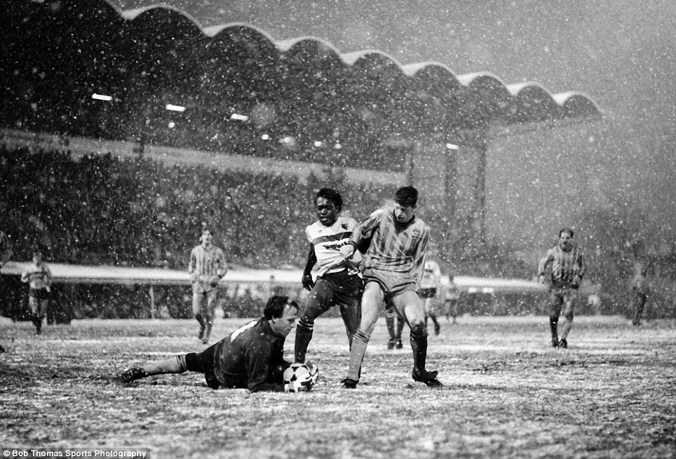 Coventry City goalkeeper Steve Ogrizovic saves at the feet of Watford's Worrell Sterling (centre) as defender Brian Borrows looks on during the FA Cup 3rd round match held at Highfield Road, Coventry on 4th January 1986.  Watford beat Coventry City 3-1.  (Bob Thomas/Getty Images).