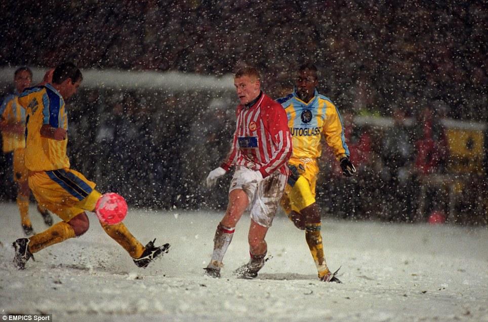 Robin Berntsen of Tromso (centre) plays the ball past Chelsea's Steve Clarke (left) as Eddie Newton of Chelsea (right) looks on
