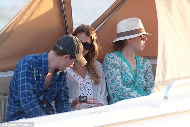 Feeling pensive? The star sported a white wide-brimmed hat as she sat next to friends