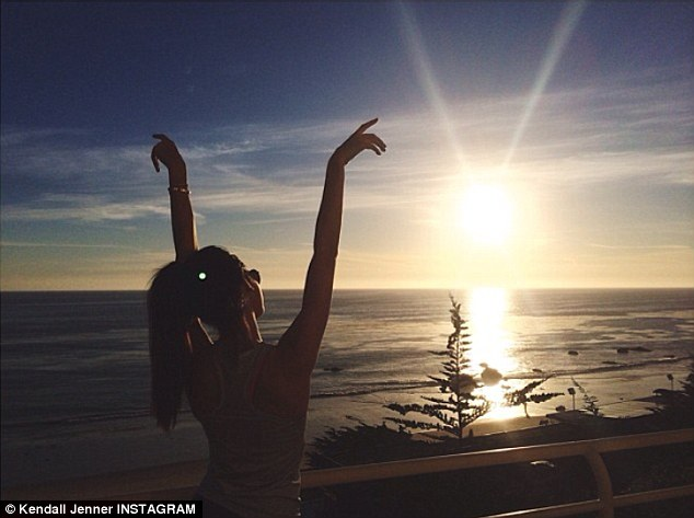 Follow the sun: Kendall Jenner meanwhile posted a photo of the sun setting over the ocean