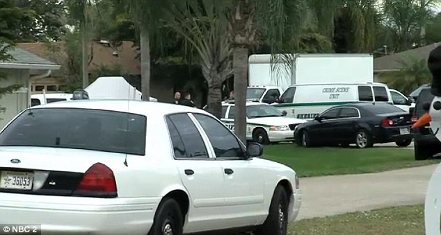 Swarmed: More than a dozen police vehicles descended on the San Carlos Park home