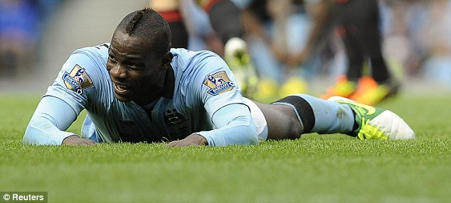 City slicker: Mario Balotelli sported a mohican during his time in Manchester