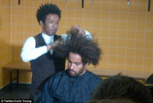 Chop chop: Lance gets to work on Huddlestone's afro