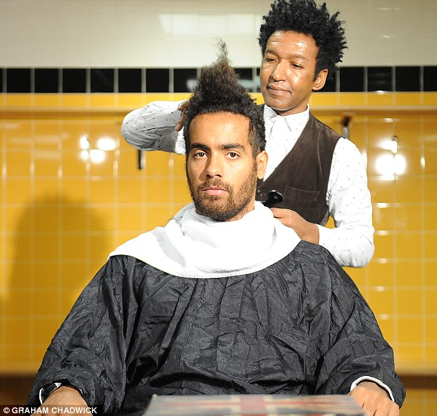 Taking shape: Huddlestone's new do begins to take on a style