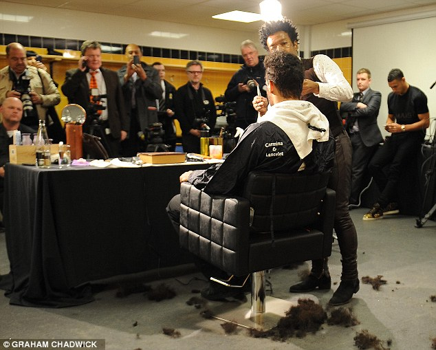 Centre of attention: Press and team-mates gather in the dressing-room