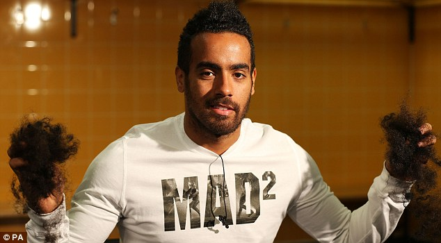 Mad for it: Huddlestone had refused to have his hair cut until he scored a goal