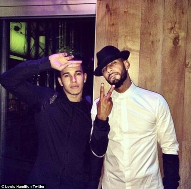 Rapper friends: Wannabe rapper Lewis Hamilton brought in the new year with American musician Swizz Beats