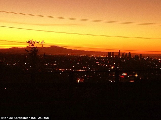 Morning has broken: The doll posted this shot at 7 am on Thursday with the message, 'City Of Angels'
