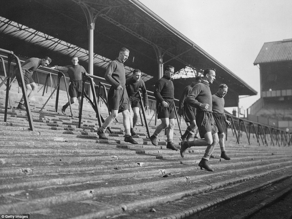 17th January 1938:  Tottenham Hotspur FC soccer team in training, running up and down the terrace at White Hart Lane, London. Left to right: Hall, Gibbons, Ward, Page, Hitchins, Sargent and Whatley.  (Photo by Davis/Topical Press Agency/Getty Images)