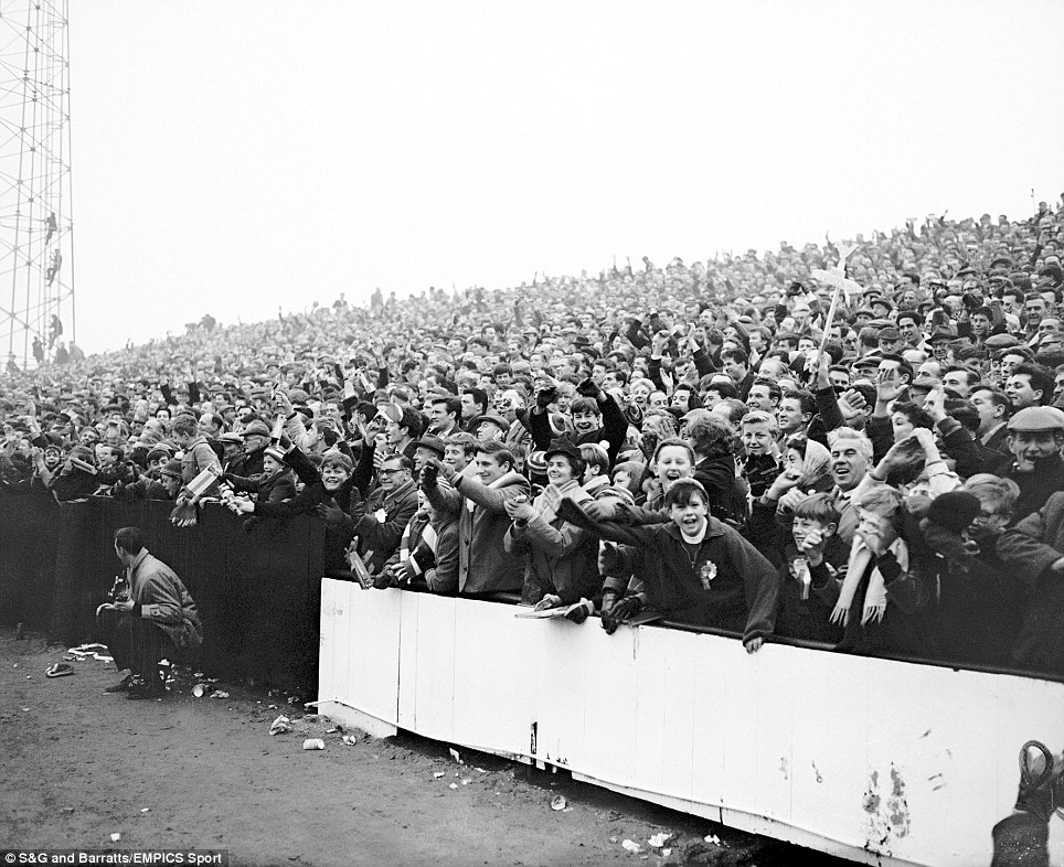 Swindon Town fans celebrate their team's only goal of the match