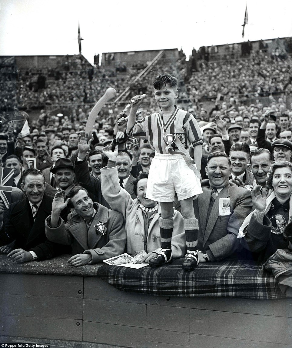 Football, 1957 FA Cup Final, Wembley Stadium, 4th May, 1957, Aston Villa 2 v Manchester United 1, A proud young Villa fan dressed in the team colours on the terraces before the match  (Photo by Popperfoto/Getty Images)