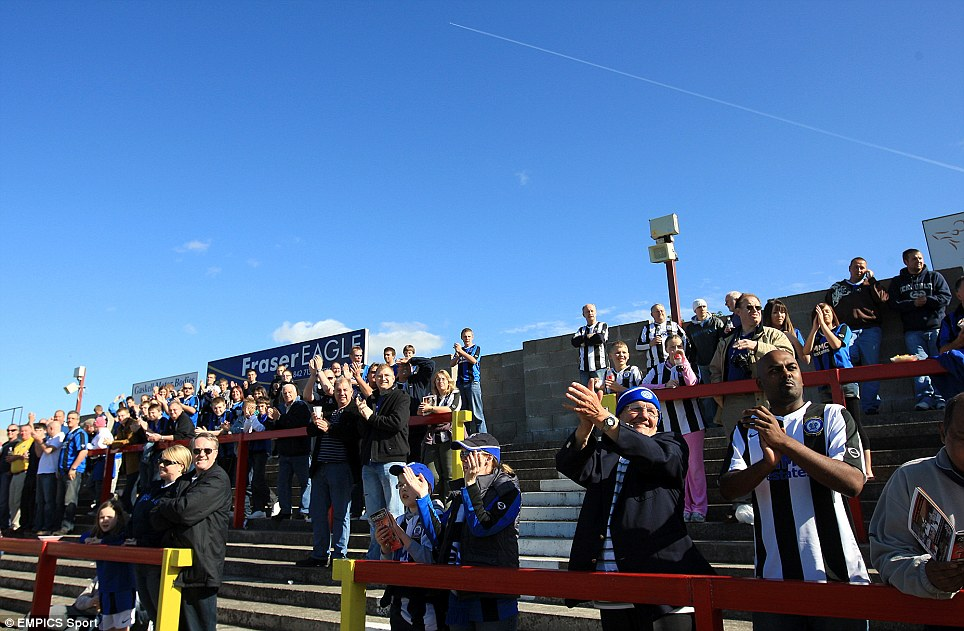 Fans on the terraces at Accrington Stanley's Fraser Eagle Stadium