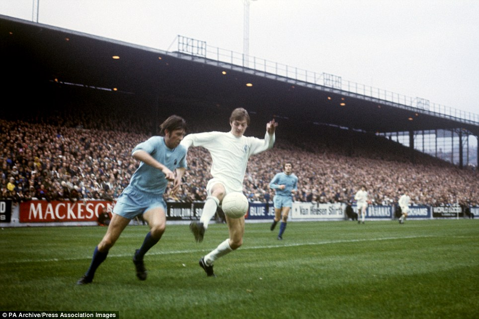 Leeds United's Allan Clarke (r) and Coventry City's Michael Coop (l) battle for the ball.