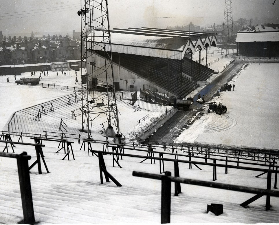 The severe winter 1963: Ground staff at Charlton Football Club's stadium, 'The Valley' are pictured working to get the pitch passed for the next day's football match. The match was postponed after it was inspected by referee Bill Buckley.