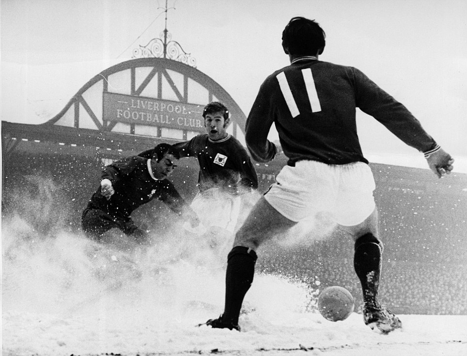 Liverpool v Nottingham Forest. 15th February 1969. Ian St. John clears the ball in a flurry of snow at Nottingham's Forest Joe Baker and Ron Rees comes sliding in.