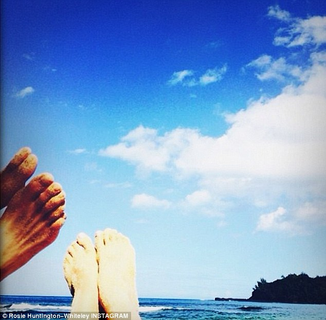 Toe to toe: Rosie shared a picture of her and her boyfriend Jason Statham's toes