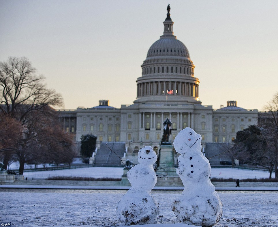 Snowmen sit in front of the Capitol in Washington after a winter snow storm bored down on the nation's capital
