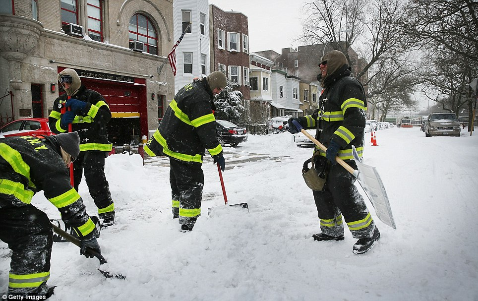 New York City Firefighters dig out of their firehouse in Brooklyn following snow storm Hercules
