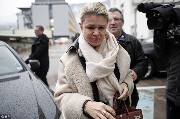 Worry: Michael Schumacher's wife, Corinna arrives at the Grenoble hospital on Friday morning