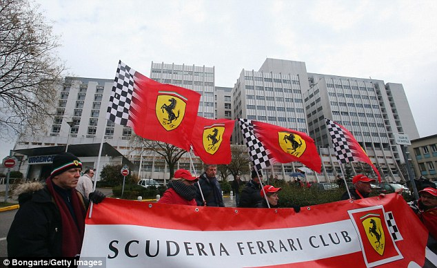 Loyal: The Ferrari team, with whom Schumacher won a record five drivers' titles in a row between 2000 and 2004, organised a 'silent march'