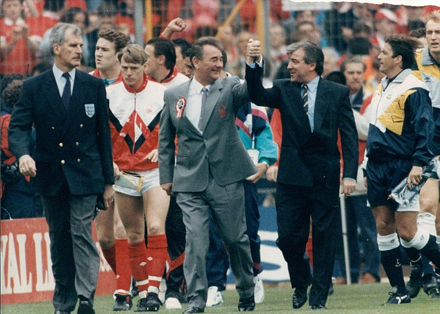 Magic of the cup: Brian Clough (left) and Terry Venables (right) holding hands as they lead out Nottingham Forest and Tottenham Hotspur for the 1991 FA Cup Final at Wembley
