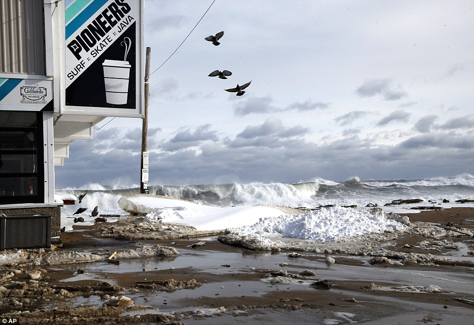 Rough surf floods a street along Salisbury Beach in Massachusetts on Friday as the East Coast was battered by winter storm Hercules