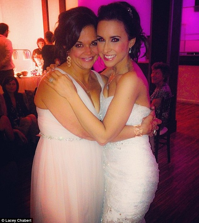 Wedding belle: Lacey Chabert announced her wedding via Twitter on Friday with this photo alongside sister Crissy, but refrained from naming her groom