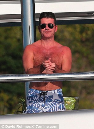 Nice: Cowell gazes out from his vantage point on the Slipstream's top deck