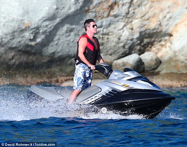 Thrill seeker: Cowell ploughs through the waters off the coast of St. Barts