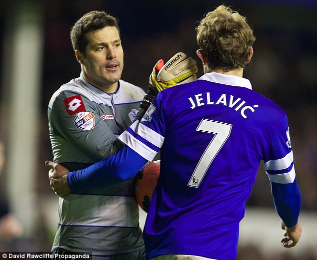 Better luck next time: Cesar pats Jelavic on the back of the head following the striker's penalty miss