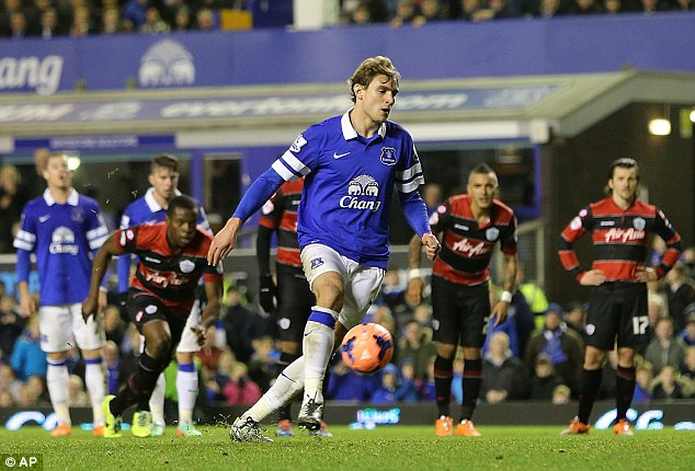 Confident: Nikica Jelavic attempted to chip his penalty as Everton and QPR players prepare to race into the box