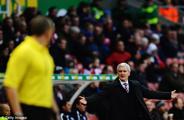 Pushing it: Stoke manager Mark Hughes remonstrates with the officials during the match